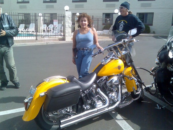 A great lady with a beautiful Harley Davidson