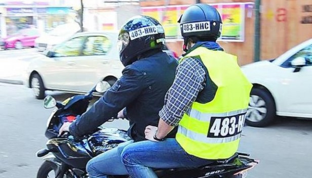 Reflective vests with printed license plate and license plate sticker on helmet